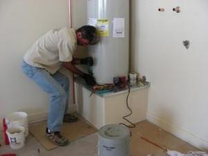 Dave in the middle of a water heater repair in Bellevue, WA